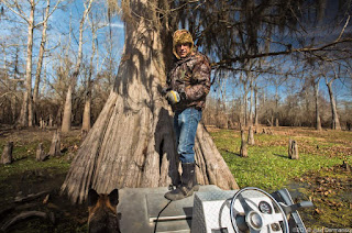 Dean Wilson in the Atchafalaya Basin in front of a cypress tree in the proposed path of the Bayou Bridge pipeline.  [Image Credit: (c) 2018 Julie Dermansky] Click to Enlarge.