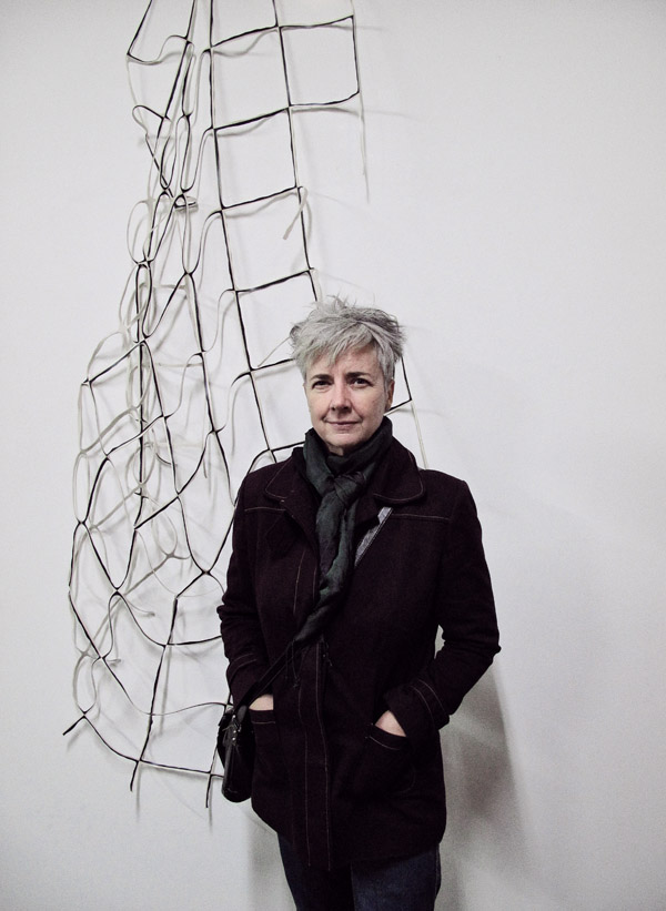 "Sally Clarke, Artist Portrait with ""Power Play"" Installation at Factory 49 opening night."