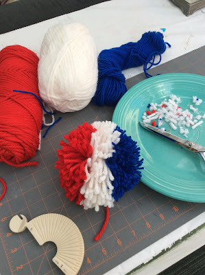 red white blue pom poms stefanie girard, 4th of july, pompoms, wine topper, decoration