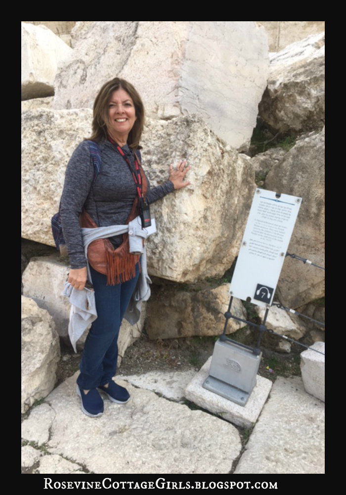 Holy Land - photo of Debbie standing near the stones tha built the temple