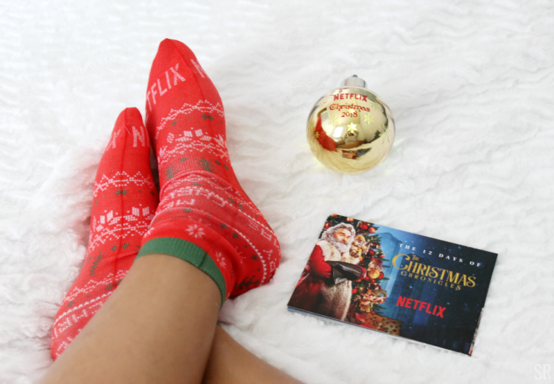 a woman wearing red Netflix Christmas socks
