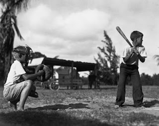 Two boys playing baseball picture