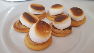 s'mores made with ritz crackers, marshmallows, chocolate and peanut butter