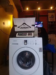mesin cuci interior ruangan di nut kopi dan laundry
