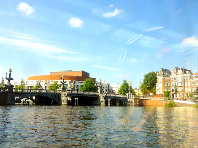 River view from a canal cruise boat in Amsterdam  | Netherlands, Europe