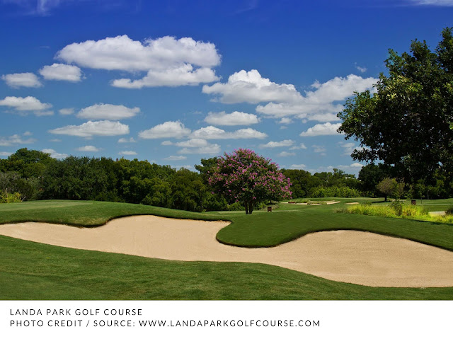 large sand traps and scattered clouds