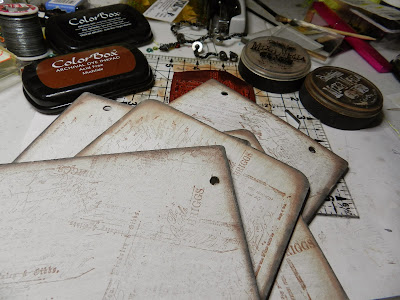 Prepped chipboard pages painted and distress inked