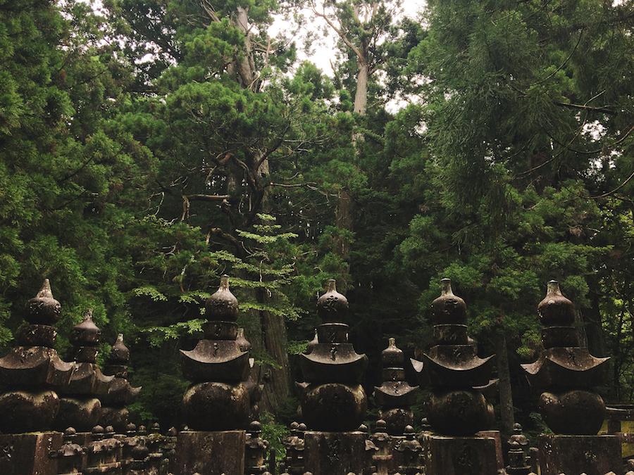 Stone figureheads in Okunoin Cemetery Koyasan Japan