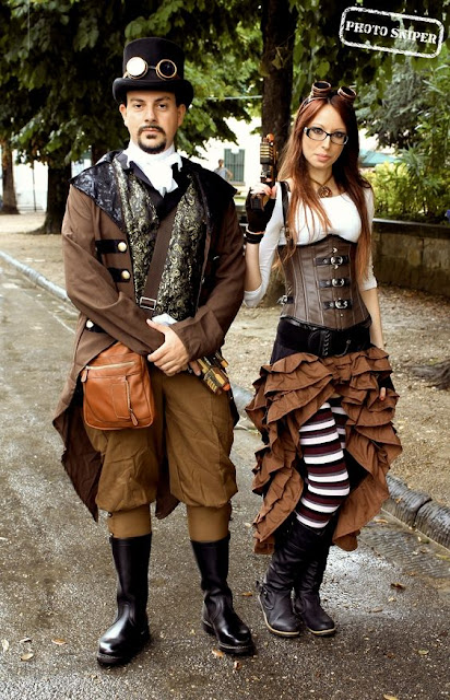 Matching costume for steampunk couple. man and woman wearing steampunk clothing in shades of brown