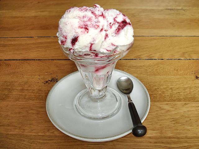 Sundae dish full of raspberry ripple ice cream