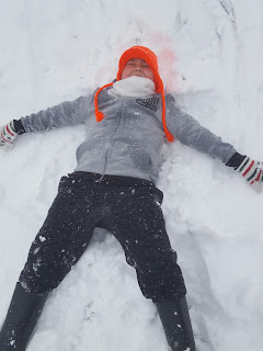 Dan Jon making a Snow Angel