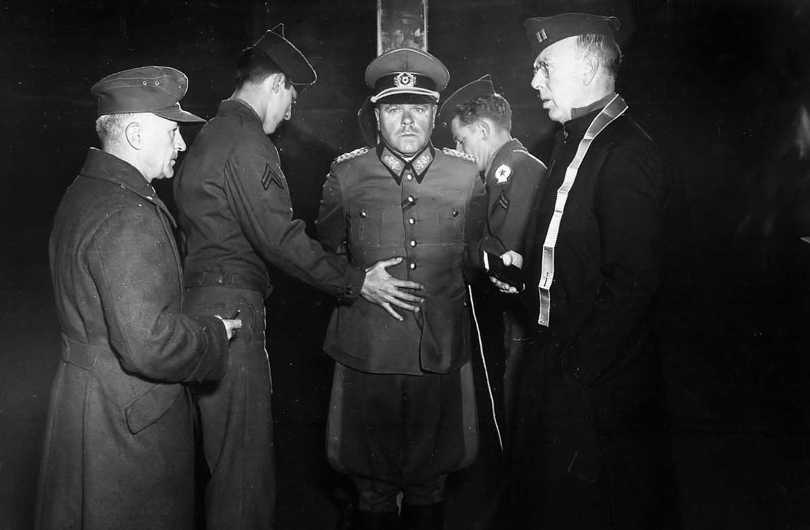 German Wehrmacht General Anton Dostler is tied to a stake before his execution by a firing squad in a stockade in Aversa, Italy, on December 1, 1945. The General, Commander of the 75th Army Corps, was sentenced to death by an United States Military Commission in Rome for having ordered the shooting of 15 unarmed American prisoners of war, in La Spezia, Italy, on March 26, 1944