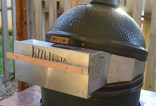 Pizza Porta fitted on a Large Big Green Egg. They also fit on a Kamado Joe.
