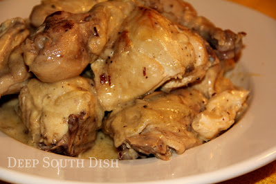 A whole cut up chicken, baked in a creamy sauce, with caramelized onion, mushrooms and almonds.