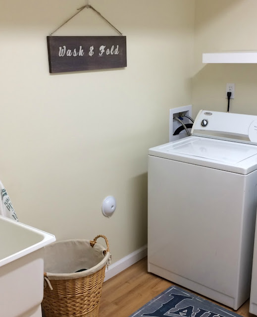 Use Wood Accelerator to age a plain board and make a stenciled farmhouse laundry sign!