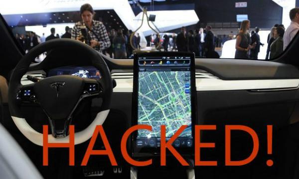 """بالفيديو: قرصنة سيارة """"تيسلا"""" عن طريق تطبيق """"برغر"""" مجاني!"""