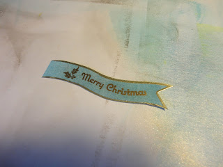 Blue and gold banner with Merry Christmas sentiment