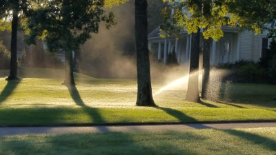 auto sprinkler system watering the grass during 2016 drought
