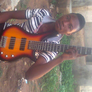 Bass guitarist with his five stringed bass guitar