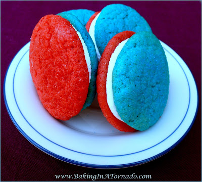Red Fluff and Blue Cookies, for 4thof July or any time, soft sugar cookies with a marshmallow filling. | Recipe developed by www.BakingInATornado.com | #recipe #cookies #snack