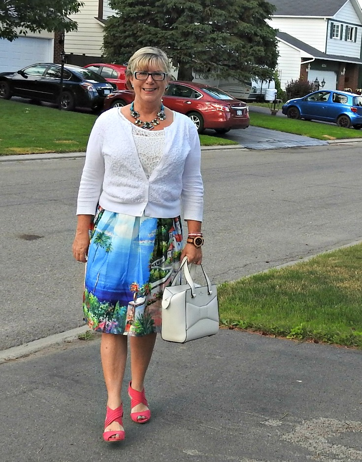 Shein seascape skirt, a crop top, lace cardigan and a Kate Spade Beau Bag. With pink Kmart pumps and a Jord Watch