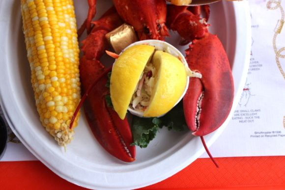 This fresh Main lobster served with corn, lemons, and coleslaw is delicious.