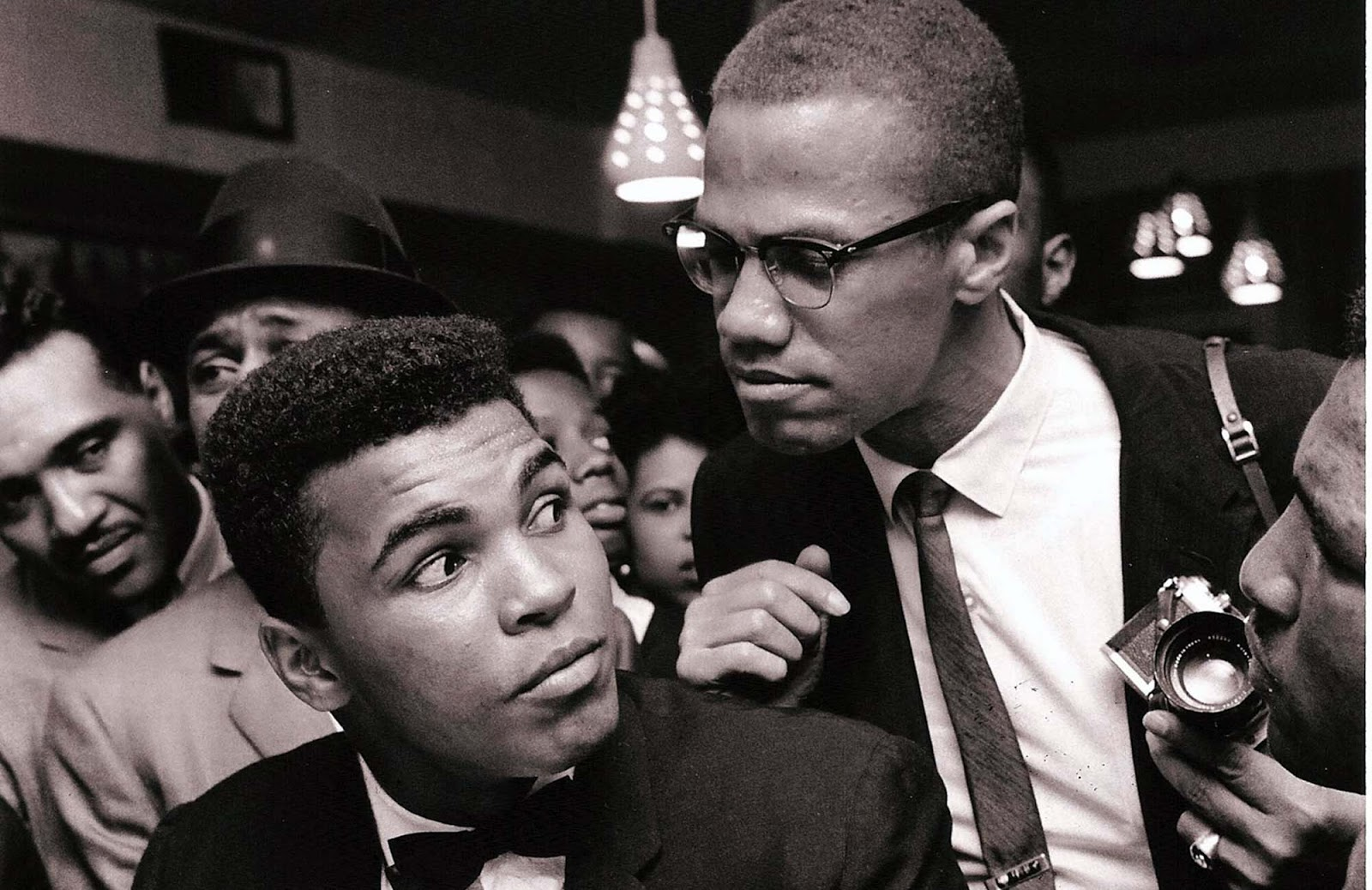 Malcolm X kidding around with Muhammad Ali, New York, 1963.