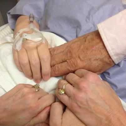 Breast cancer previvor reality. Hands joined at the hospital before a mastectomy.