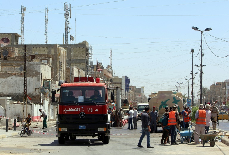 File picture shows Iraqi emergency personnel at the site of a bombing in the capital Baghdad