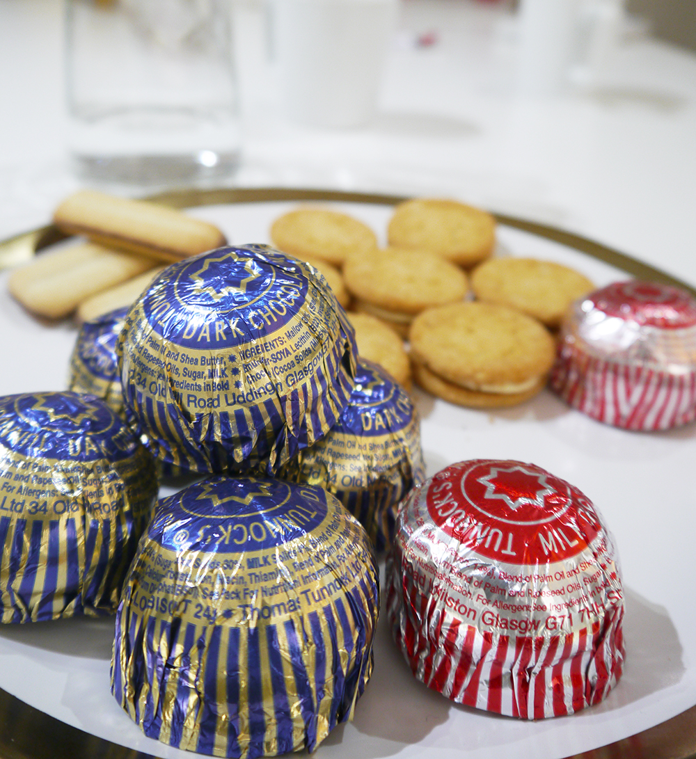 Plate of Tunnocks tea cakes, red and blue tunnocks tea cakes, Fox biscuits, biscuit pyramid