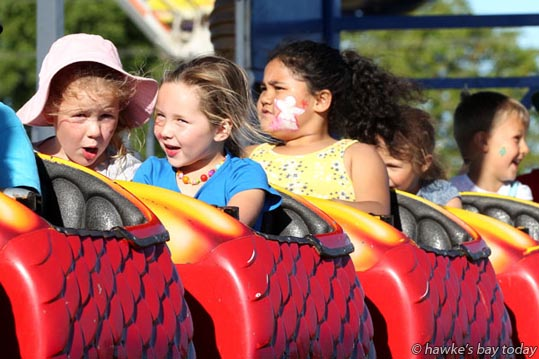L-R: Hannah Lunn, 6, Taradale, Isla Clark, 4, Hastings, on the Dragon Wagon, Mahons Amusements and carnival, a first time attraction at Cox Partners Hawke's Bay Christmas at the Park, Hawke's Bay A&P Showgrounds, Hastings. photograph