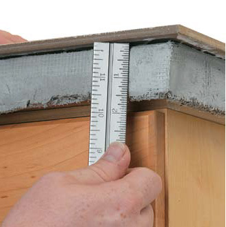 Determine The Required Width Of Edge Tiles Lay A Field Tile Onto Base So It Overhangs Front By 1 2 Hold Metal Rule Up To