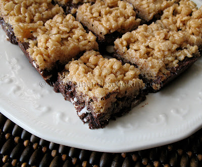 A close up photo of chewy cookie crunch bars on a white plate.