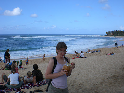 Drinking from a coconut on the beach in Hawaii