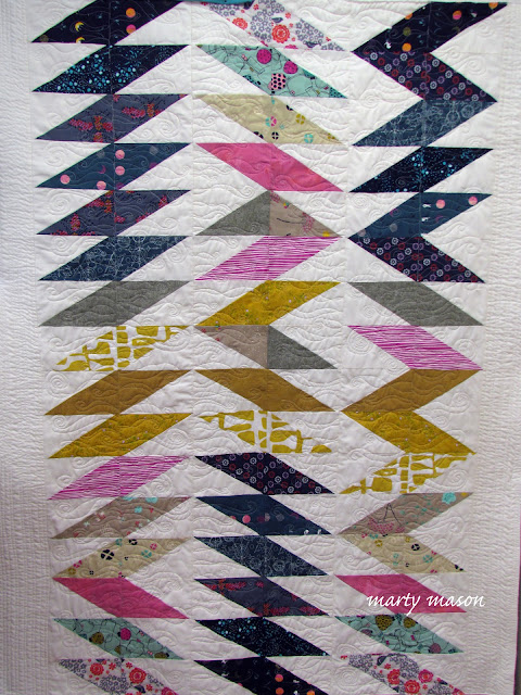 Improv pieced and free-motion quilted half-rectangle triangle quilt by Marty Mason