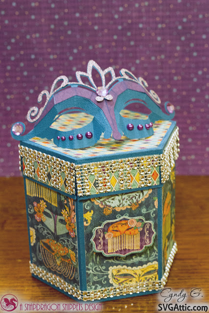 Hexagon box with masquerade mask on top