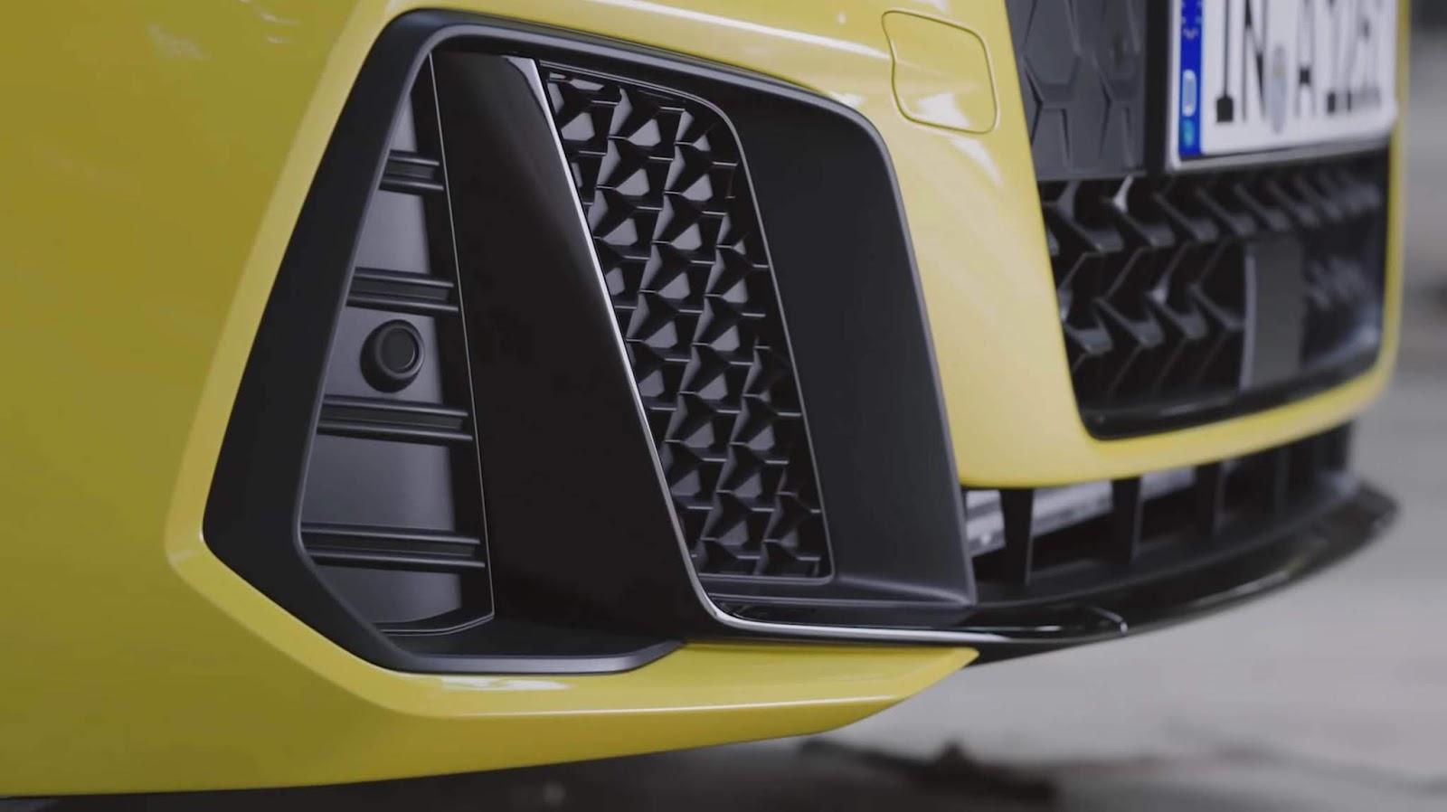 audi a1 2019 colore giallo dettaglio paraurti anteriore, prese d'aria e griglia singla frame