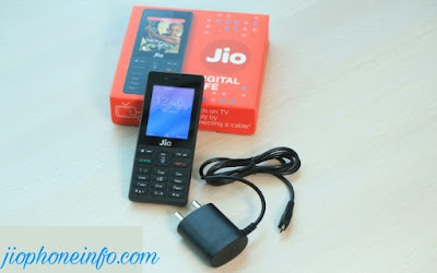 unboxed jio phone with charger put on right side