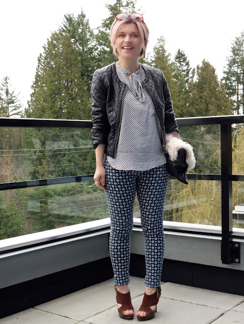 styling printed pants with a polka-dotted bow-front blouse and quilted pleather jacket