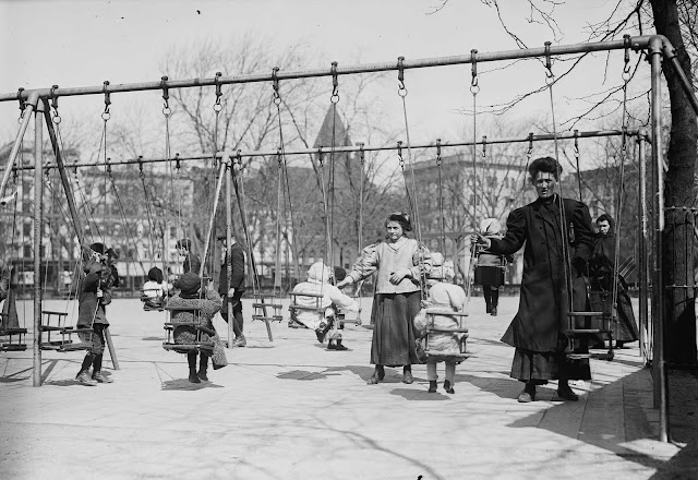 Children in swings, Hamilton Fish Park, New York.