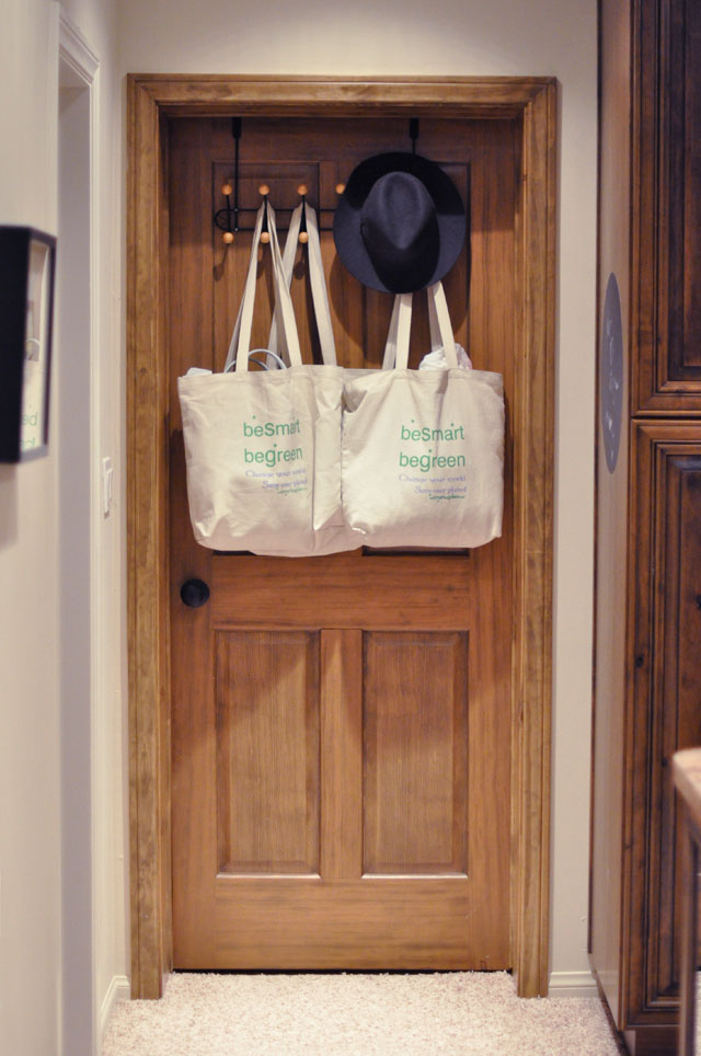 wood door, hooks, canvas bags hanging