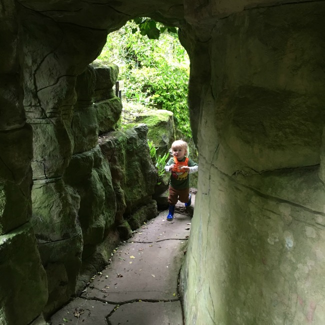 toddler in entrance to grotto