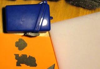 stiker buatan sendiri dan alat gosok wajan