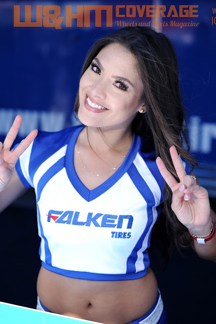Falken Tire Umbrella Girl Randyl Dawn in Falken midriff baring top and shorts