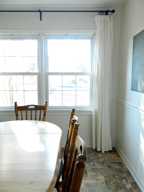 I love long flowy white curtains in our farmhouse kitchen dining area by the table, and my favorite curtain hanging method is a curtain rod and ring clips.Obviously, ring clips aren't the only way to hang curtains but there are three reasons why this curtain hanging style is my favorite...
