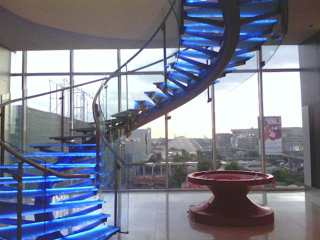 Philippines hotel stairs in blue glass