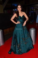 Raashi Khanna in Dark Green Sleeveless Strapless Deep neck Gown at 64th Jio Filmfare Awards South ~  Exclusive 033.JPG