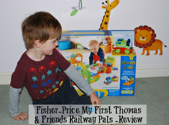 fisher-price-my-first-thomas-&-friends-railway-pals-review-text-over-image-of-toddler-with-boxed-toy