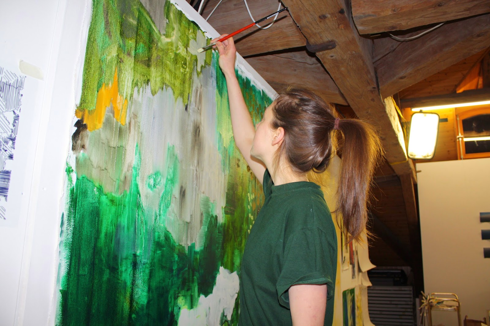 Abigail Box in the Trélex studio making paintings