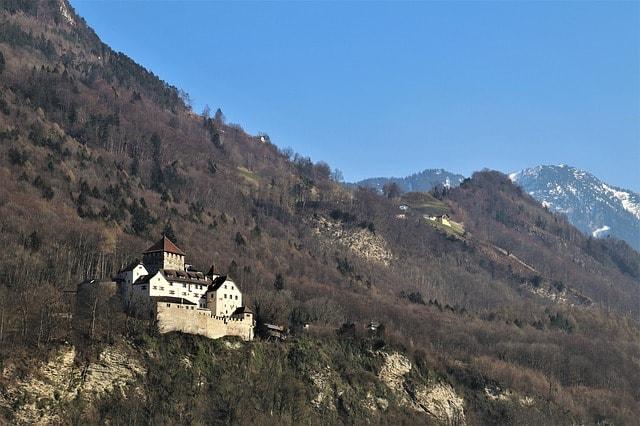 Vaduz Castle with Swiss Alps in the background in Liechtenstein